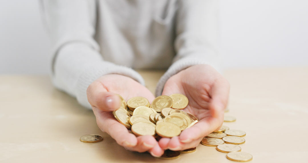 Woman holding lots of coins